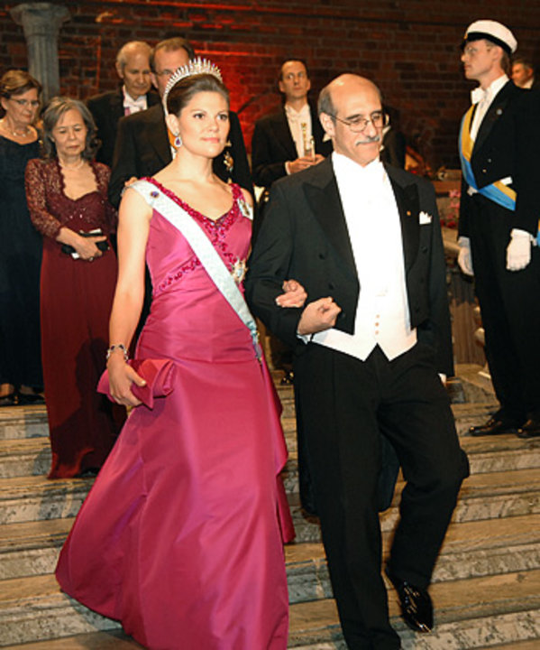Swedish Crown Princess Victoria of Sweden is accompanied by Martin Chalfie down the stairs to the Nobel Banquet