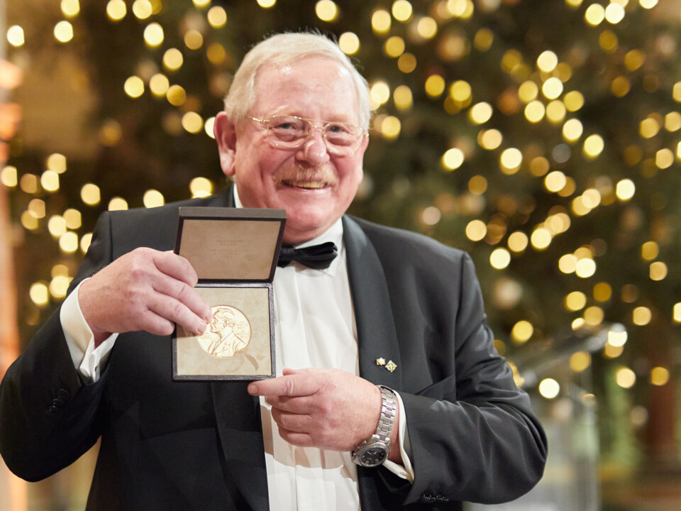 Reinhard Genzel showing his Nobel Prize medal.