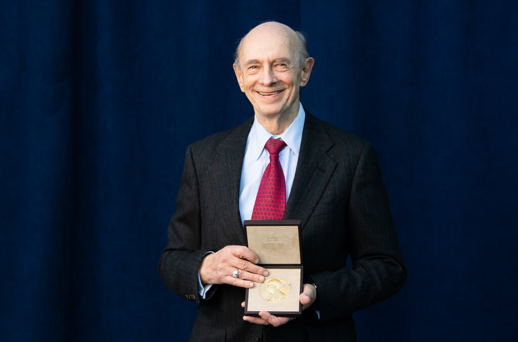 Photo of Harvey J Alter with his Nobel Prize medal