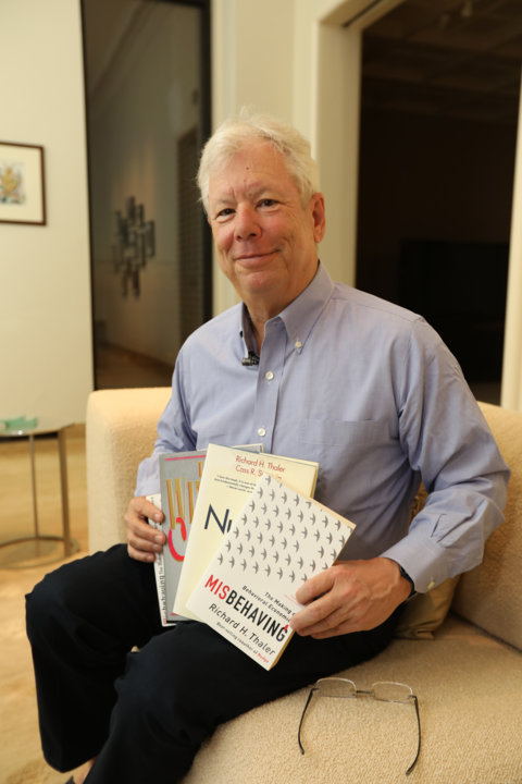 Richard Thaler poses with his books.
