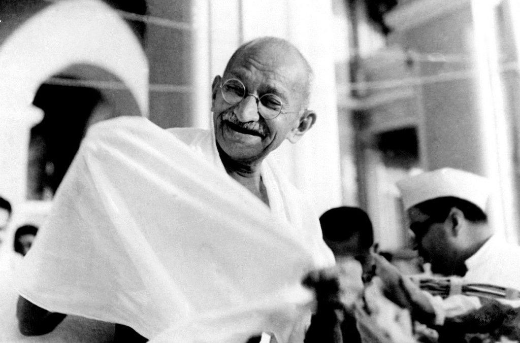 Mahatma Gandhi laughing