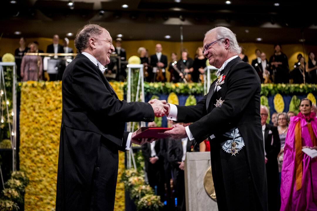 Sir Gregory P. Winter receiving his Nobel Prize