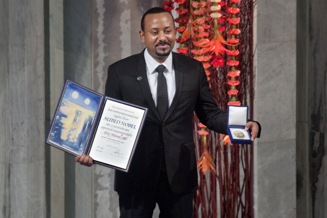 Ethiopian Prime Minister Abiy Ahmed Ali showing his Nobel Prize medal and diploma