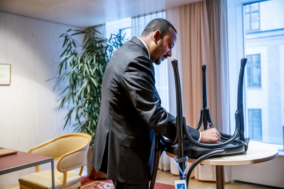 Abiy Ahmed Ali autographs a chair