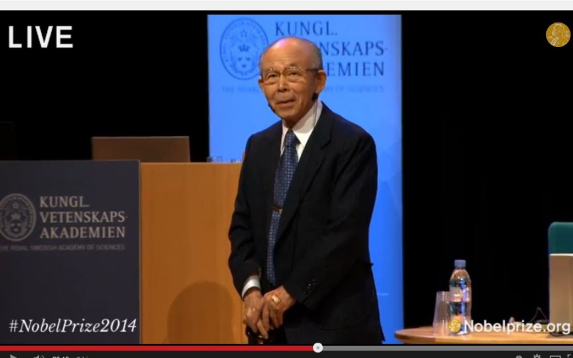 Isamu Akasaki delivering his Nobel Lecture Fascinated Journeys into Blue Light in the Aula Magna, Stockholm University, 8 December 2014
