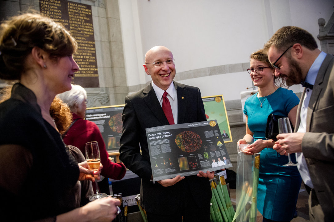 Stefan W. Hell with a poster about the 2014 Chemistry Prize at the Nobel Foundation reception at the Nordic Museum in Stockholm, 9 December 2014.