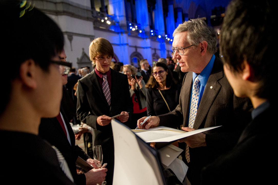 William E. Moerner autgraphing posters during the Nobel Foundation reception at the Nordic Museum in Stockholm, 9 December 2014.