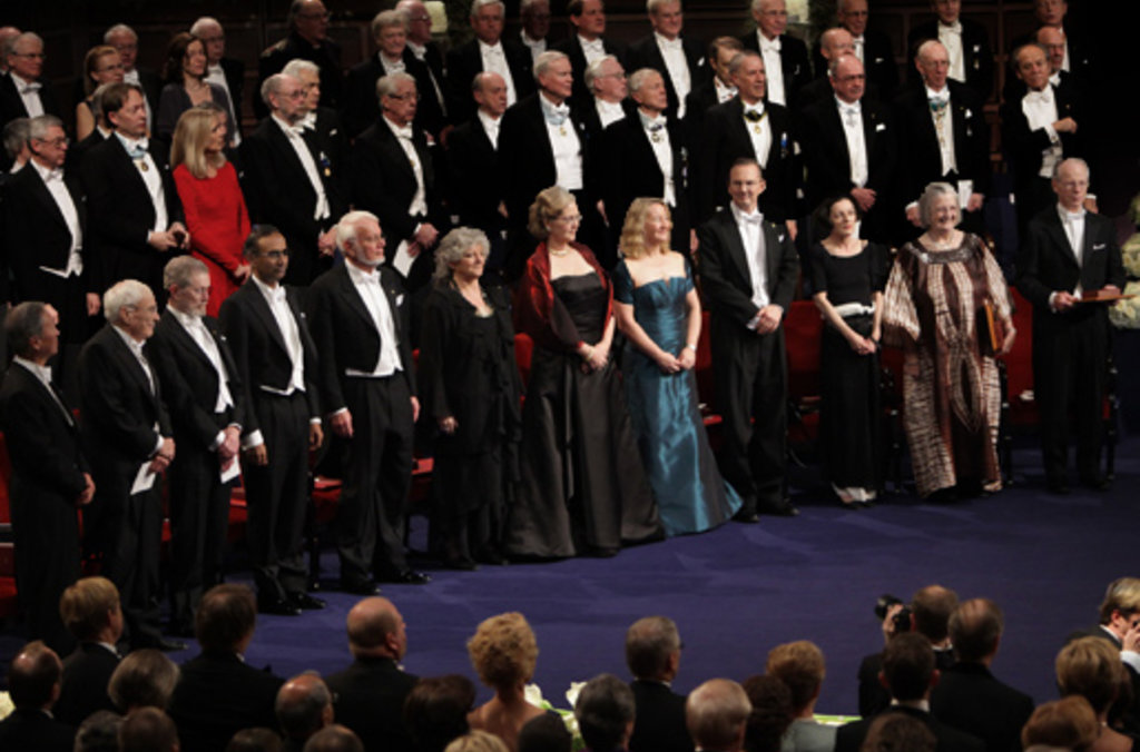 The 2009 Nobel Laureates stand for the Swedish national anthem