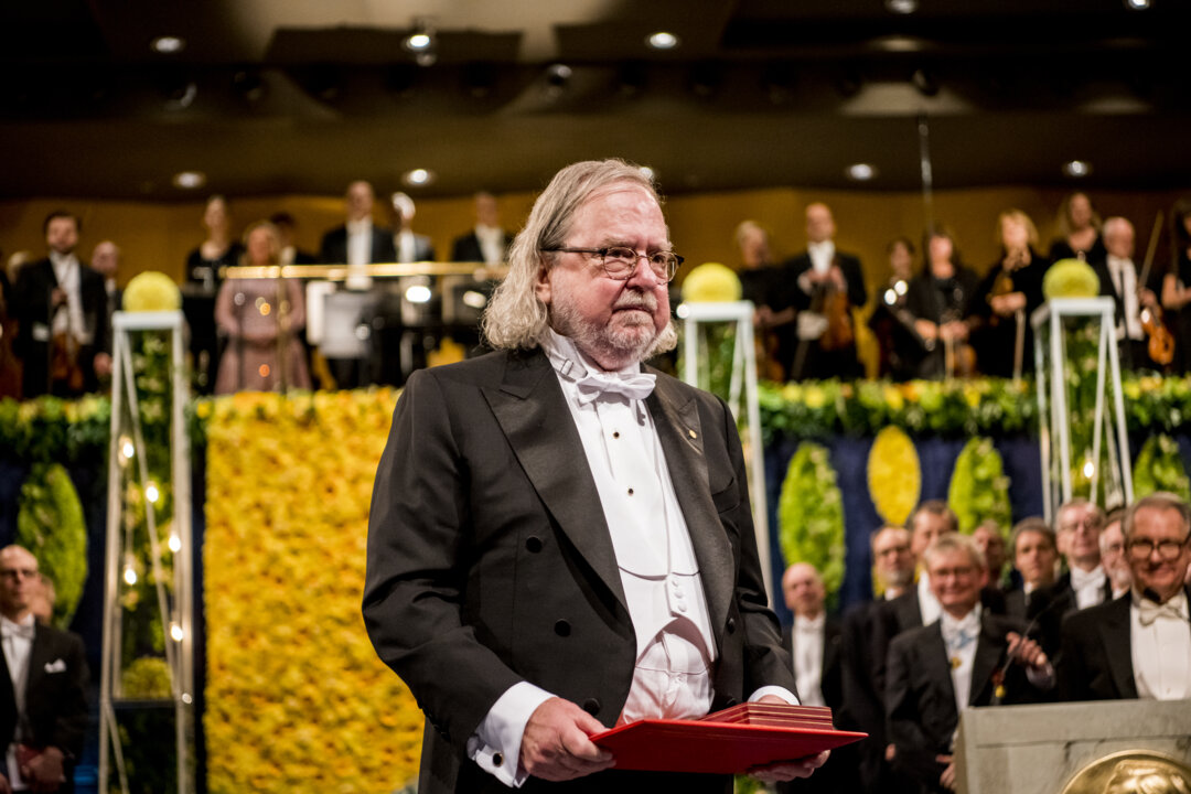James P. Allison at award ceremony