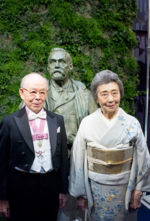 Isamu Akasaki with his wife, Mrs Ryoko Akasaki, on stage after the Nobel Prize Award Ceremony at the Stockholm Concert Hall.