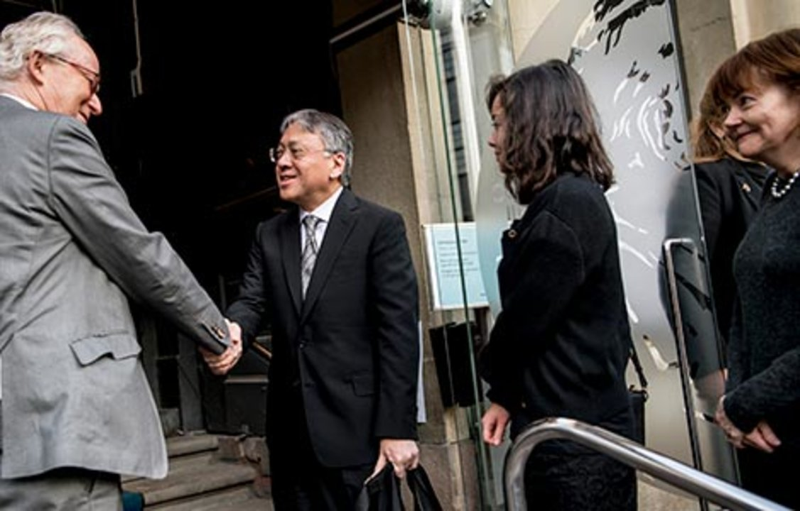 Kazuo Ishiguro receives a hearty handshake from Lars Heikensten