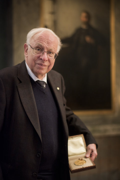 Tomas Lindahl showing his Nobel Medal during his visit to the Nobel Foundation on 12 December 2015. On this occasion, the Laureates retrieve the Nobel diploma and Medal, which have been displayed in the Golden Hall of the City Hall following the Nobel Prize Award Ceremony. The Laureates also discuss the details concerning the transfer of their prize money.