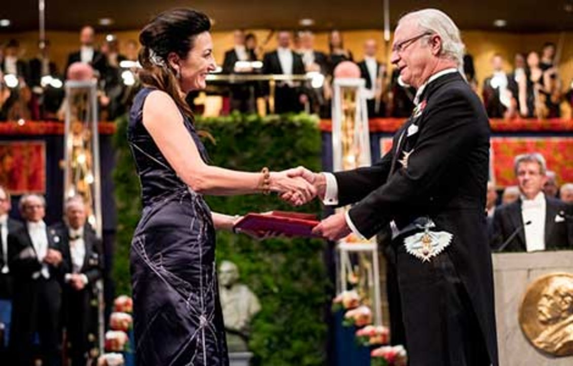 May-Britt Moser receiving his Nobel Prize from His Majesty King Carl XVI Gustaf of Sweden