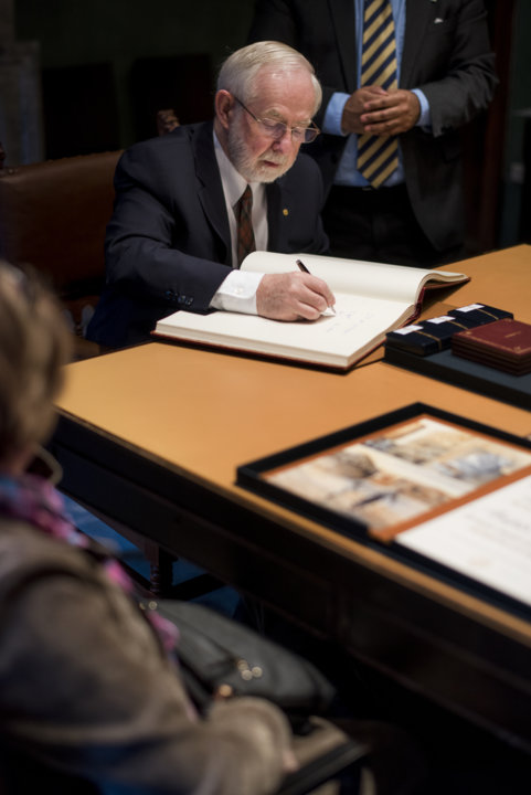 Arthur B. McDonald signs the Nobel Foundation's guest book, signed by the Laureates since 1952, during his visit to the Nobel Foundation on 12 December 2015.