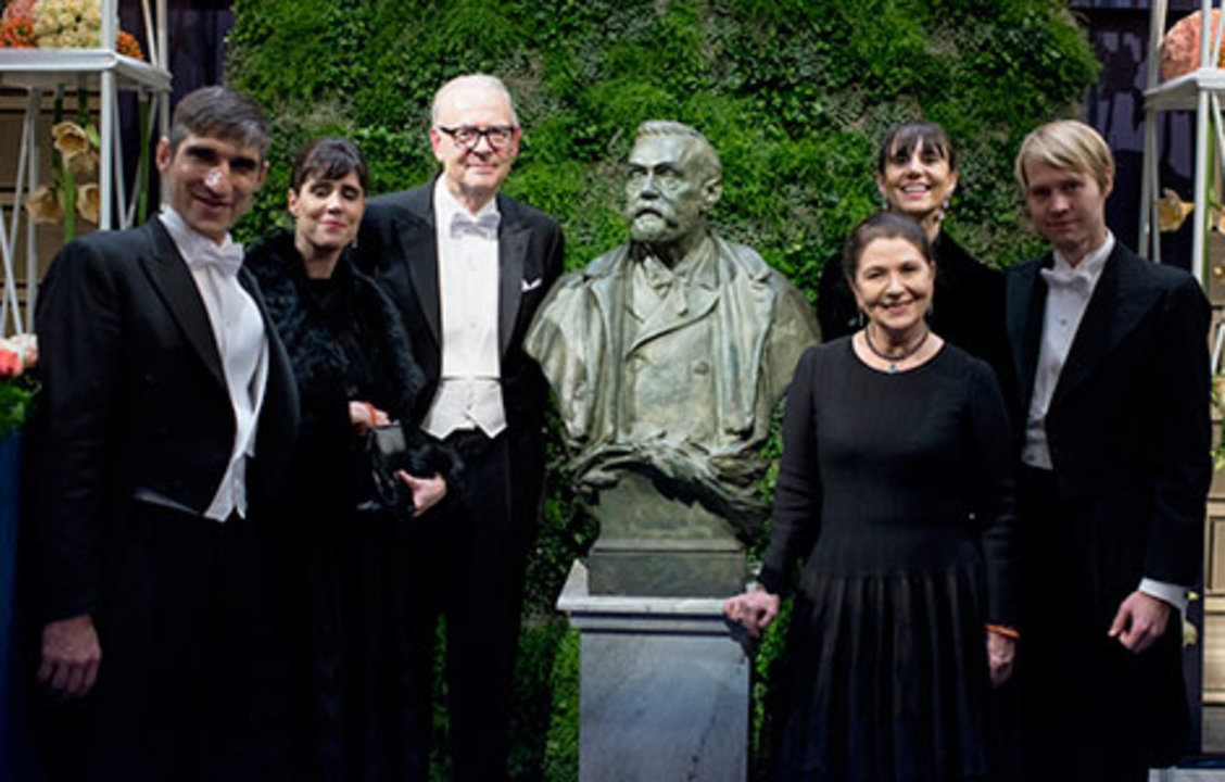 Patrick Modiano with family and relatives on stage after the Nobel Prize Award Ceremony at the Stockholm Concert Hall, 10 December 2014.
