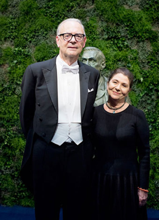 Patrick Modiano with his wife, Mrs Dominique Modiano, on stage after the Nobel Prize Award Ceremony at the Stockholm Concert Hall.