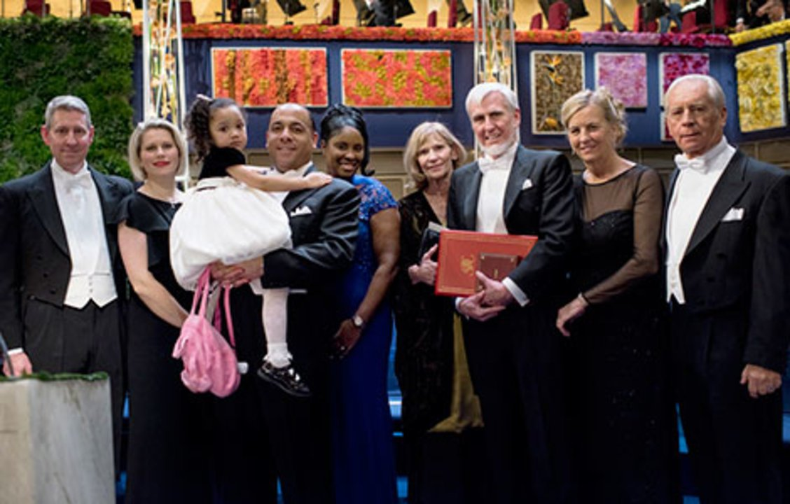 John O'Keefe with family and relatives on stage after the Nobel Prize Award Ceremony at the Stockholm Concert Hall, 10 December 2014.