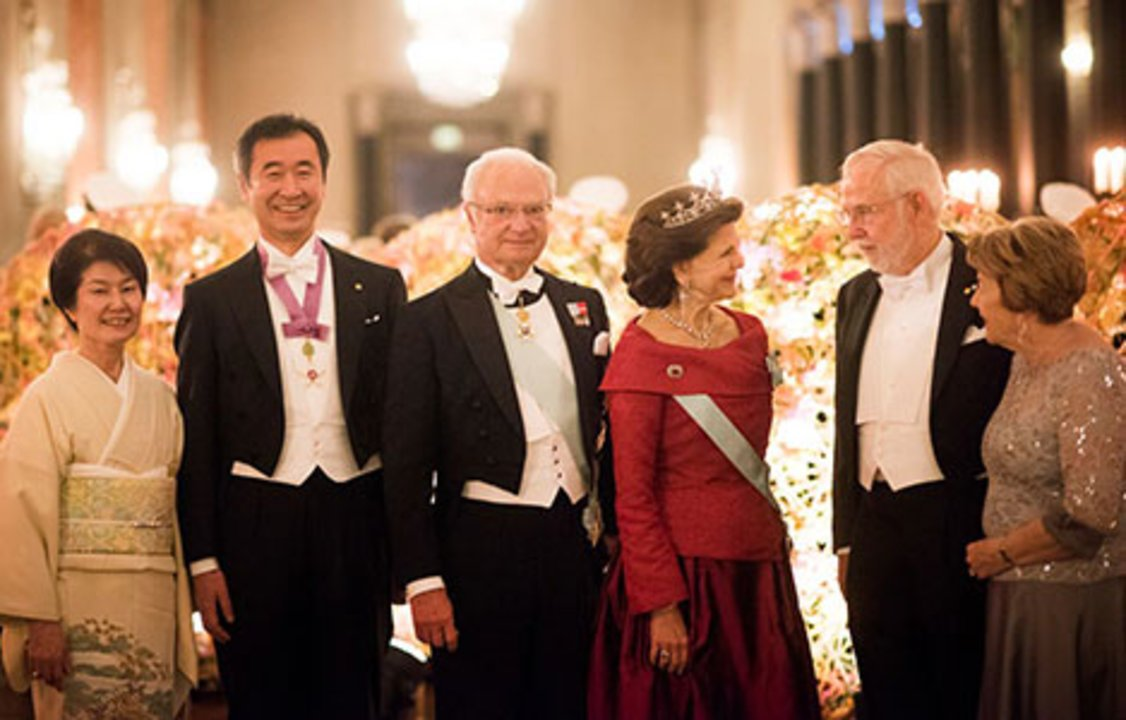 The Swedish Royal Family receives the Laureates and their significant others in the Prince's Gallery. From left: Michiko Kajita, parther of Takaai Kajita, Takaai Kajita, King Carl XVI Gustaf and Queen Silvia of Sweden, Arthur B. McDonald and his wife, Mrs Janet McDonald.