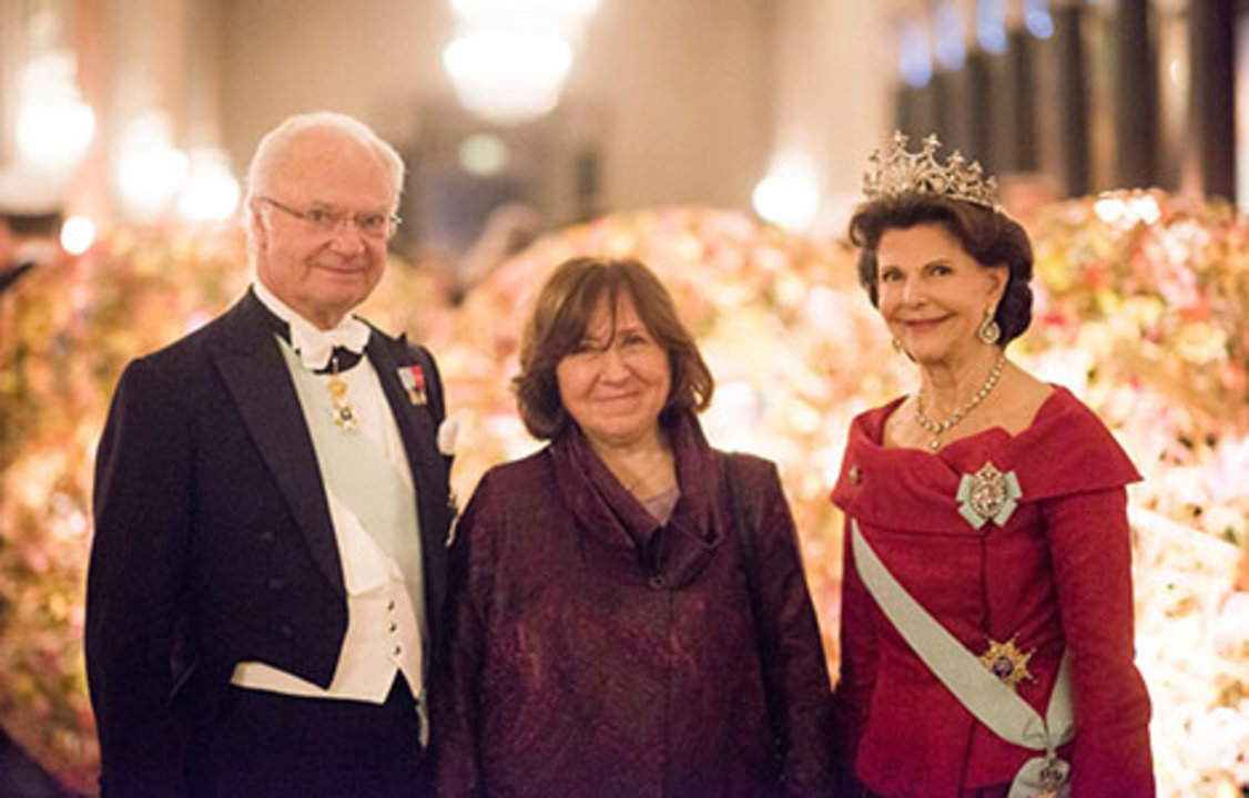 The Swedish Royal Family receives the Laureates and their significant others in the Prince's Gallery. From left to right: King Carl XVI Gustaf of Sweden, Literature Laureate Svetlana Alexievich and Queen Silvia of Sweden.