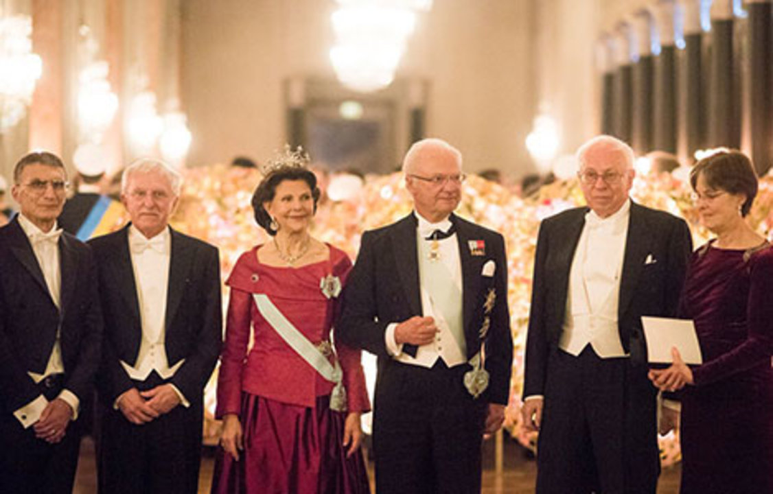 The Swedish Royal Family receives the Nobel Laureates and their significant others in the Prince's Gallery. From left: Chemistry Laureates Aziz Sancar and Paul Modrich, Queen Silvia and King Carl XVI Gustaf of Sweden, Chemistry Laureate Tomas Lindahl, and Dr Vickers Burdett, partner of Paul Modrich.