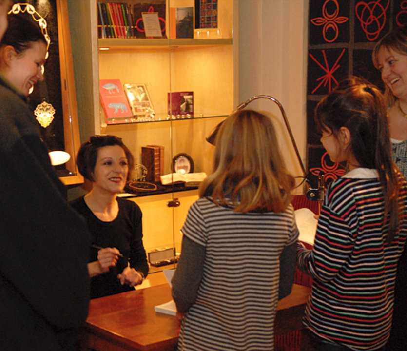 Herta Müller signing books in the Nobel Museum in Stockholm