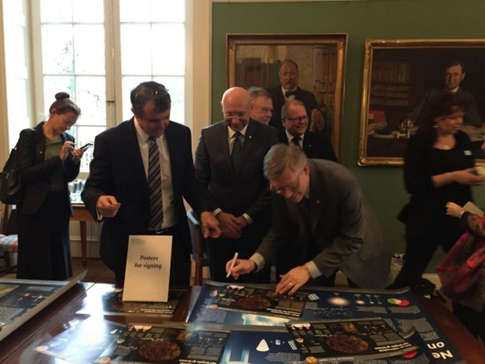 All three Chemistry Laureates signing posters at the Royal Swedish Academy of Sciences on 7 December 2014.