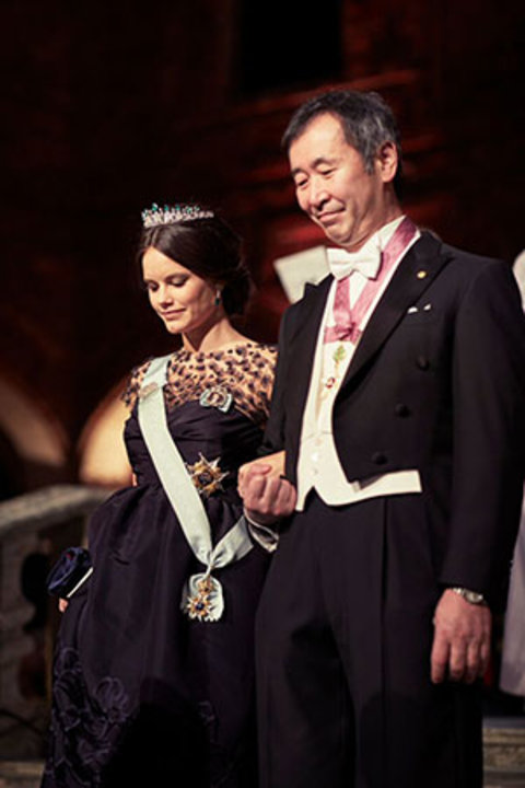Takaaki Kajita and Princess Sofia of Sweden proceed into the Blue Hall of the Stockholm City Hall for the Nobel Banquet on 10 December 2015.
