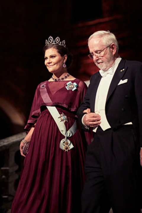 Arthur B. McDonald and Crown Princess Victoria of Sweden proceed into the Blue Hall of the Stockholm City Hall for the Nobel Banquet on 10 December 2015.