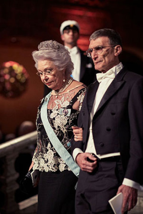 Aziz Sancar and Princess Christina of Sweden proceed into the Blue Hall of the Stockholm City Hall for the Nobel Banquet on 10 December 2015.
