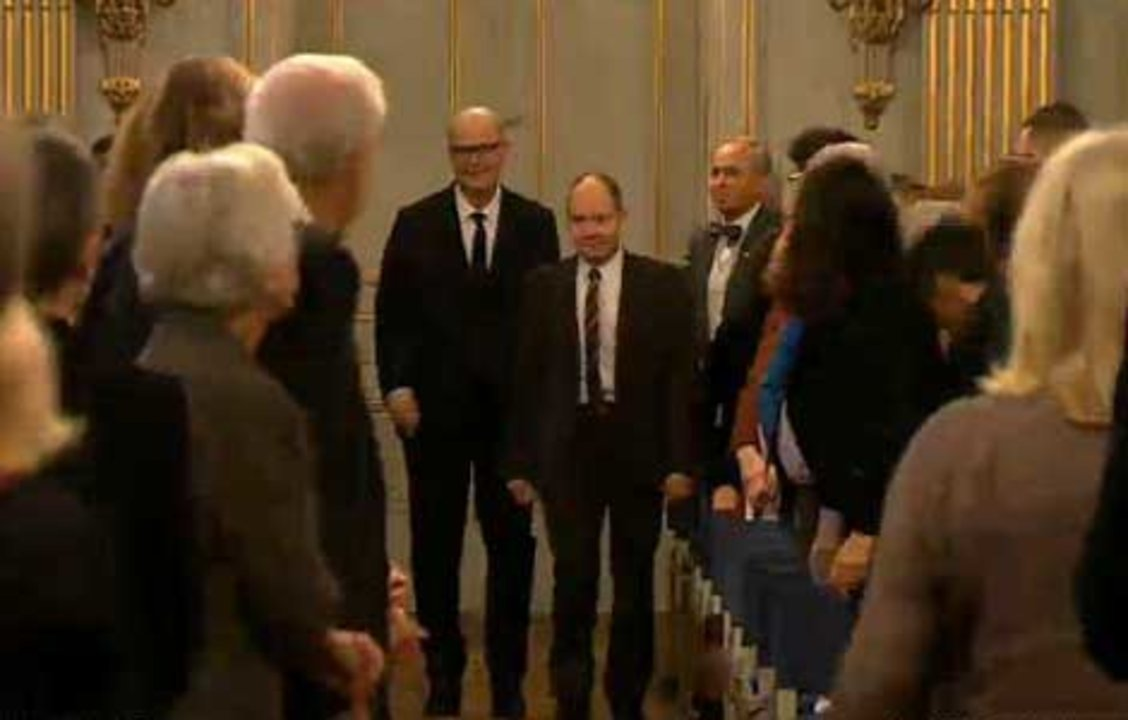 Patrick Modiano and Peter Englund, Permanent Secretary of the Swedish Academy, enter the hall at the Swedish Academy in Stockholm, 7 December 2014.