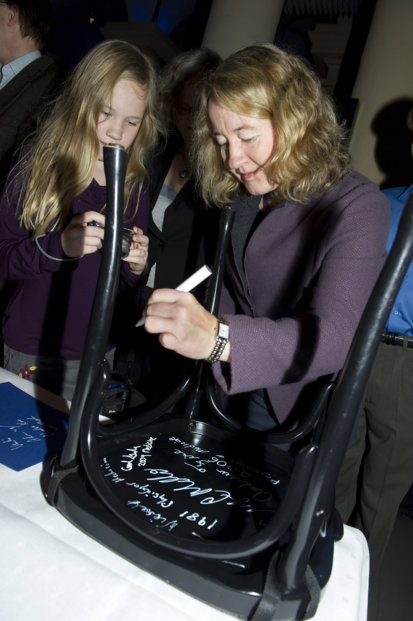 Carol W. Greider autographs a chair