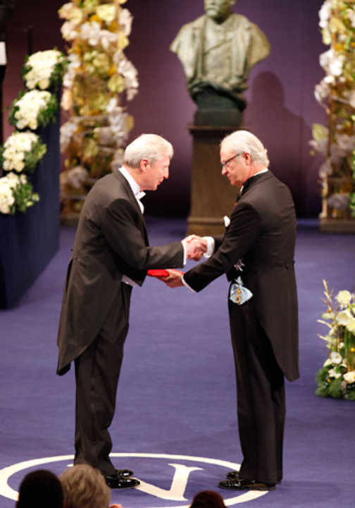 Jules A. Hoffmann receiving his Nobel Prize from His Majesty King Carl XVI Gustaf