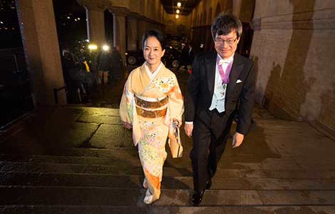 Hiroshi Amano arrives at the Nobel Banquet at the Stockholm City Hall on 10 December 2014, together with his wife, Mrs Kasumi Amano.