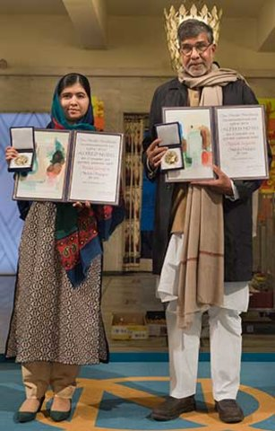 Malala Yousafzai and Kailash Satyarthi showing their Nobel medals and diplomas during the Nobel Peace Prize Award Ceremony at the Oslo City Hall in Norway, 10 December 2014.