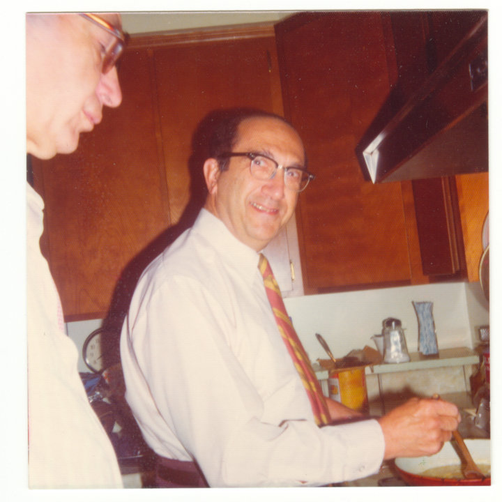Salvador Luria cooking at his home