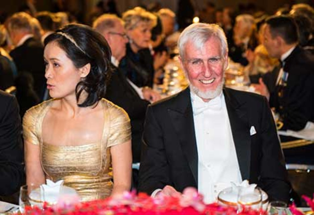 Dr Na Ji, spouse of Nobel Laureate Eric Betzig, and John O'Keefe at the table of honour at the Nobel Banquet, 10 December 2014.