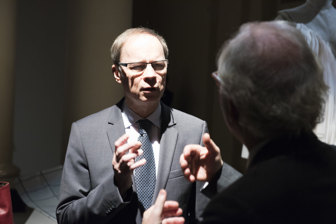 Jean Tirole discussing with the Nobel Foundation's Executive Director Lars Heikensten at the 2014 Nobel Laureates' Get together on 6 December 2014.