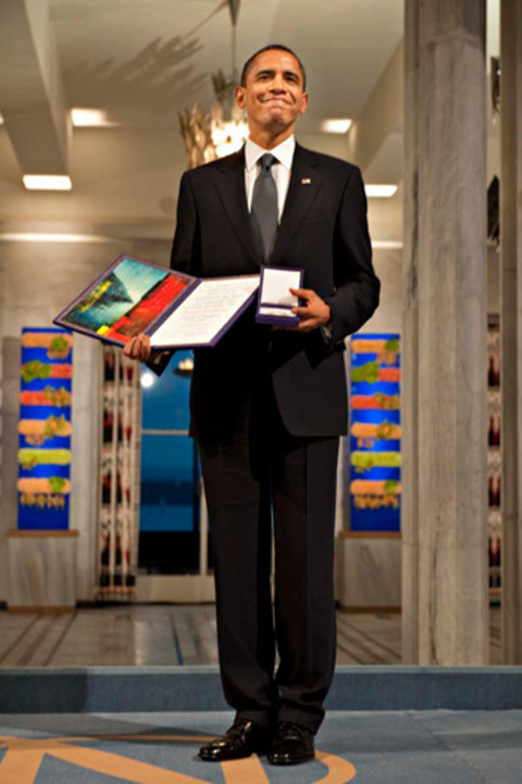 Barack H. Obama with his Nobel Peace Prize Medal and Diploma