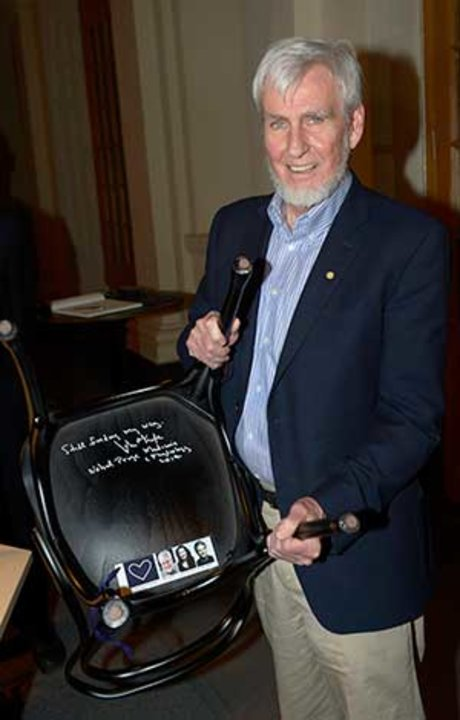 Like many Nobel Laureates before him, John O'Keefe autographs a chair at Bistro Nobel at the Nobel Museum in Stockholm, 6 December 2014.