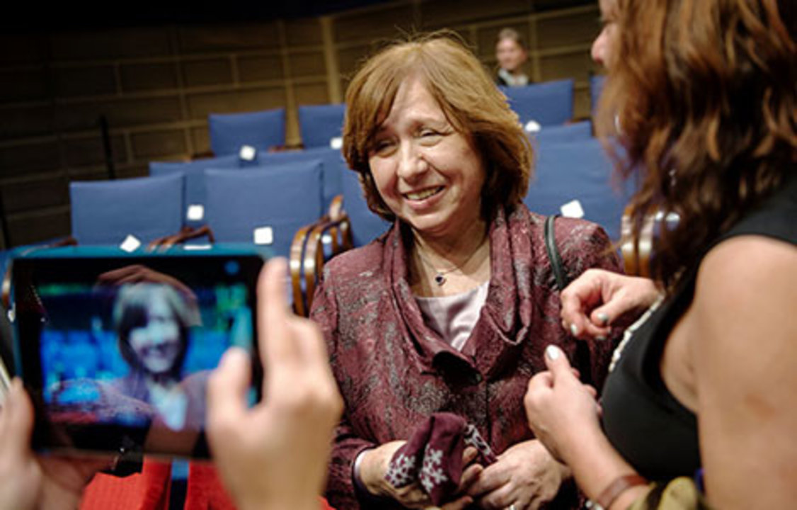 Family members and colleagues pour onto the stage to congratulate their Laureates. Svetlana Alexievich poses for a photo.