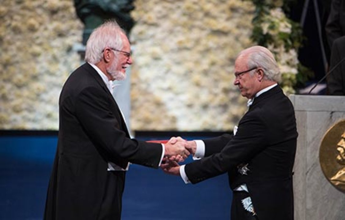 Jacques Dubochet receiving his Nobel Prize from H.M. King Carl XVI Gustaf of Sweden