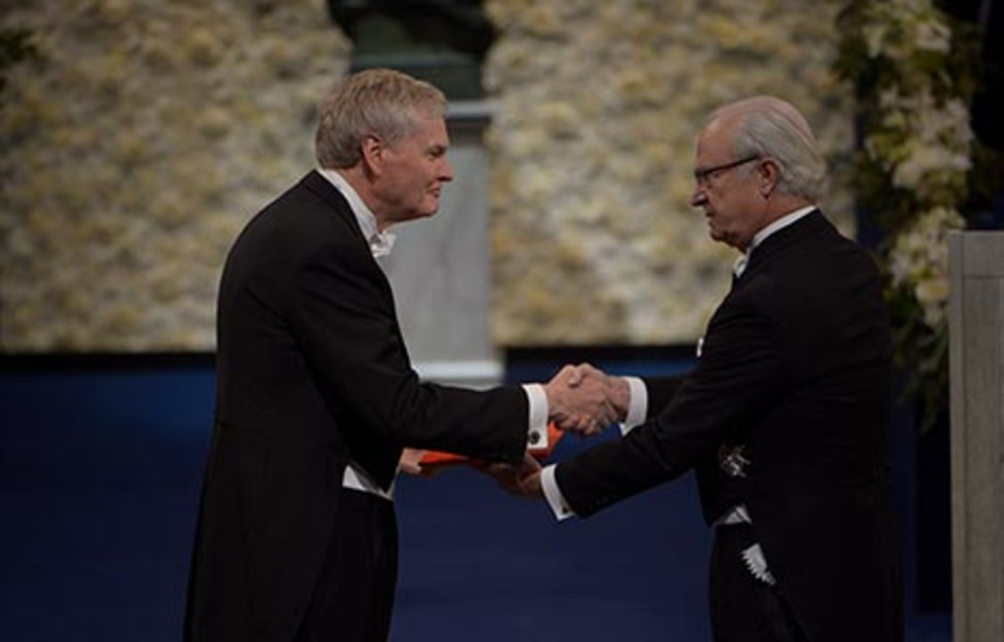 Michael W. Young receiving his Nobel Prize from H.M. King Carl XVI Gustaf of Sweden