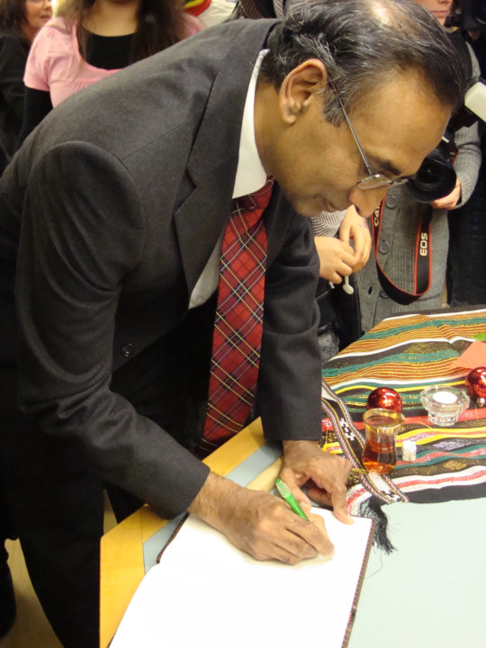 Venkatraman Ramakrishnan signing autographs for pupils