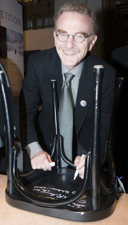 Like many Nobel Laureates before him, Randy W. Schekman autographs a chair at Bistro Nobel at the Nobel Museum in Stockholm