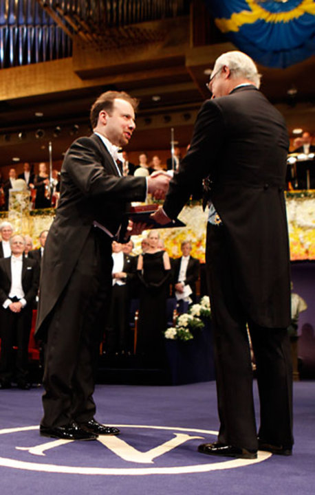 Adam G. Riess receiving his Nobel Prize from His Majesty King Carl XVI Gustaf