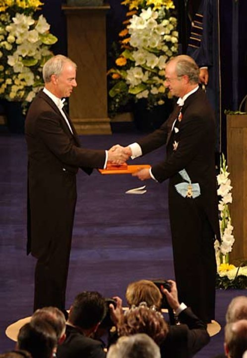 A. Michael Spence and His Majesty the King