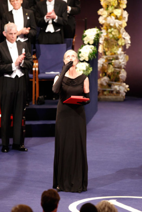 Mrs Claudia Steinman blows a kiss after receiving the Nobel Medal and Diploma on behalf of the late Professor Ralph M. Steinman