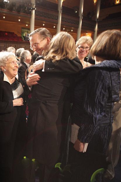 Jack W. Szostak is congratulated by his eldest son, John