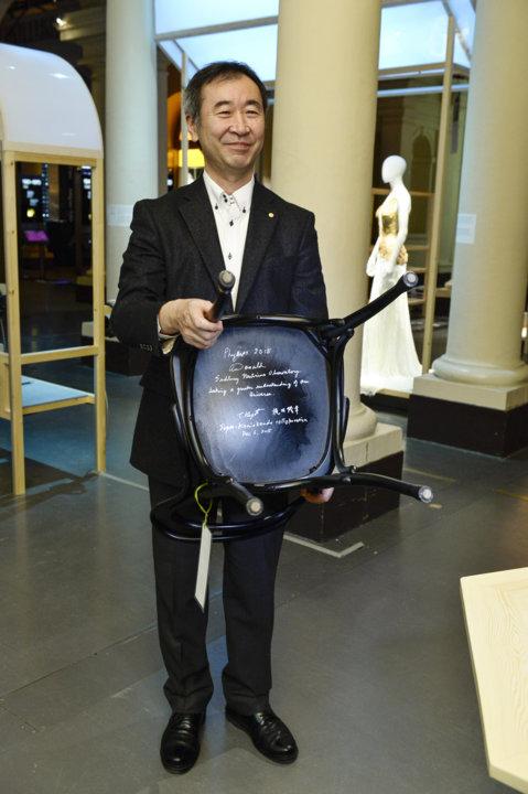 Nobel Laureate Takaaki Kajita and the autographed chair at the Nobel Museum in Stockholm.