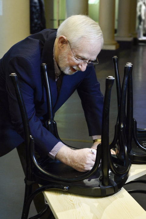 Like many Nobel Laureates before him, Arthur B. McDonald autographs a chair at Bistro Nobel at the Nobel Museum in Stockholm.